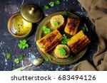 Small photo of grilled corn with salt,parsley and corn oil.the view from the top