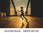 evening jog. side view of young ... | Shutterstock . vector #683518156
