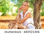 beautiful woman in olive garden ...   Shutterstock . vector #683521306