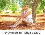 beautiful woman in olive garden ...   Shutterstock . vector #683521312