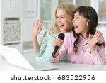 teen girls singing karaoke   Shutterstock . vector #683522956