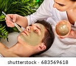 mud facial mask of man in spa... | Shutterstock . vector #683569618