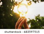 Hand Holding Light Bulb With...
