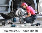 a mechanic repairs a truck.... | Shutterstock . vector #683648548