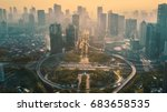 JAKARTA, Indonesia. May 12, 2017: Aerial view of circular flyover in modern city at sunset time