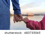 Father And Daughter Holding...