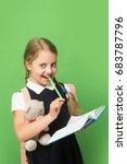 pupil holds blue book  marker... | Shutterstock . vector #683787796