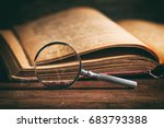 vintage book and magnifying... | Shutterstock . vector #683793388