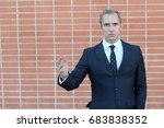Small photo of Man with commanding body language
