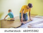 father and son installing new... | Shutterstock . vector #683955382