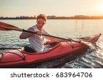 handsome sporty man is kayaking ... | Shutterstock . vector #683964706