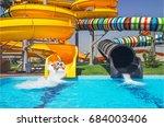 girls go down from water slide... | Shutterstock . vector #684003406