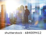 young businessman looking out... | Shutterstock . vector #684009412