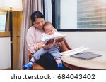 smiling mother and her cute... | Shutterstock . vector #684043402