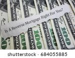 Small photo of Reverse mortgage headline on money