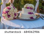 Wedding Cake And Flowers Sit O...