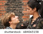 Stock photo man trying to kiss woman 684065158