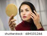 seductive woman look and mirror | Shutterstock . vector #684101266