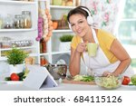 young woman preparing dinner on ... | Shutterstock . vector #684115126