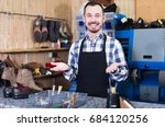 smiling man worker displaying... | Shutterstock . vector #684120256