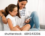 beautiful mom showing to her... | Shutterstock . vector #684143206
