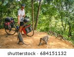 male cyclist feeding group of... | Shutterstock . vector #684151132