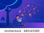 young man sitting in the park... | Shutterstock .eps vector #684165385