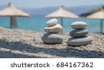 two pebble towers with sun... | Shutterstock . vector #684167362