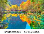 trees by the colorful lake at... | Shutterstock . vector #684198856