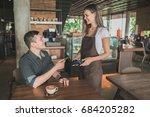 Customer Paying His Bills Usin...