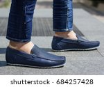 blue leather moccasins on a man | Shutterstock . vector #684257428