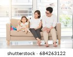 asian family on sofa | Shutterstock . vector #684263122