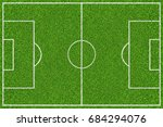 Small photo of Green soccer field with white lines. Top view background