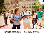Stock photo couples of international students are walking after studies holding hands chatting smile 684325948