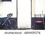 the bike parked on the wall... | Shutterstock . vector #684409276