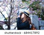 asian woman photographer is... | Shutterstock . vector #684417892