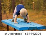 one year toddler makes yoga on... | Shutterstock . vector #684442306