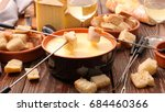 cheese fondue party on wooden... | Shutterstock . vector #684460366