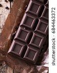 dark chocolate stack  on wooden ... | Shutterstock . vector #684463372