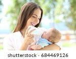 portrait of a happy mother... | Shutterstock . vector #684469126