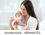 mother checking thermometer... | Shutterstock . vector #684469132