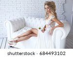 beautiful young bride in white... | Shutterstock . vector #684493102