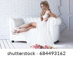 beautiful young bride in white... | Shutterstock . vector #684493162