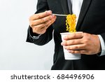man eat noodle on white... | Shutterstock . vector #684496906