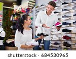 young smiling glad man seller... | Shutterstock . vector #684530965