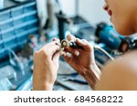 the girl works on a jewelry in... | Shutterstock . vector #684568222