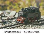 model steam locomotive in garden | Shutterstock . vector #684580906