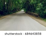 road in a forest surrounded by... | Shutterstock . vector #684643858