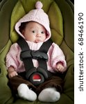 Baby girl in car seat - stock photo