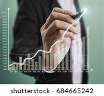 businessman drawing graphics a... | Shutterstock . vector #684665242